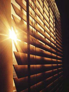 bigstock-Sun-Through-the-Blinds-75865586